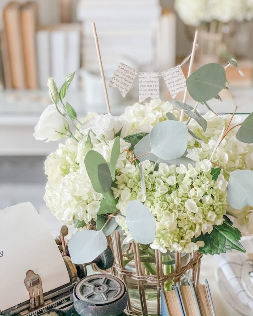 Hydrangea and Eucalyptus floral arrangement with paper banner from Live Oak Nest www.liveoaknest.com