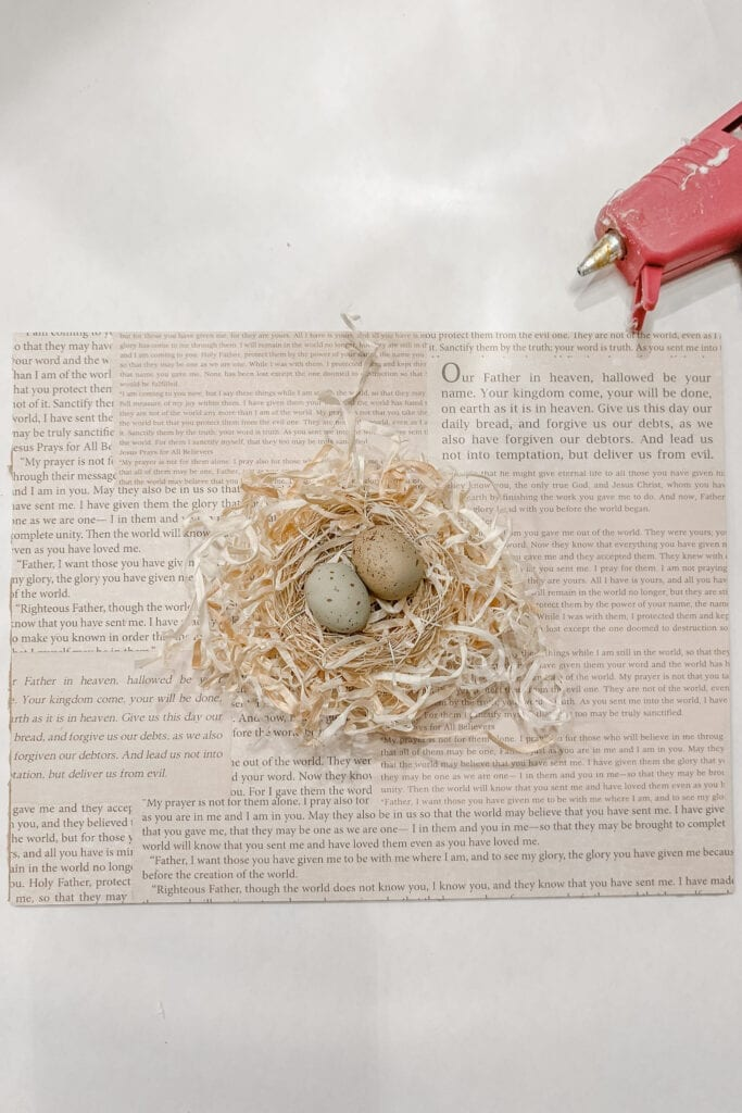 """Step 4: Once that is dry, hot glue the """"stacked"""" bird nests onto the scrapbook paper backing. Live Oak Nest www.liveoaknest.com"""
