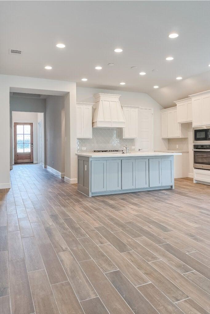 White Brick Cottage Farmhouse, New Construction Home, Wood Tile Floors, Modern Farmhouse Venthood, Quaterfoil Backsplash