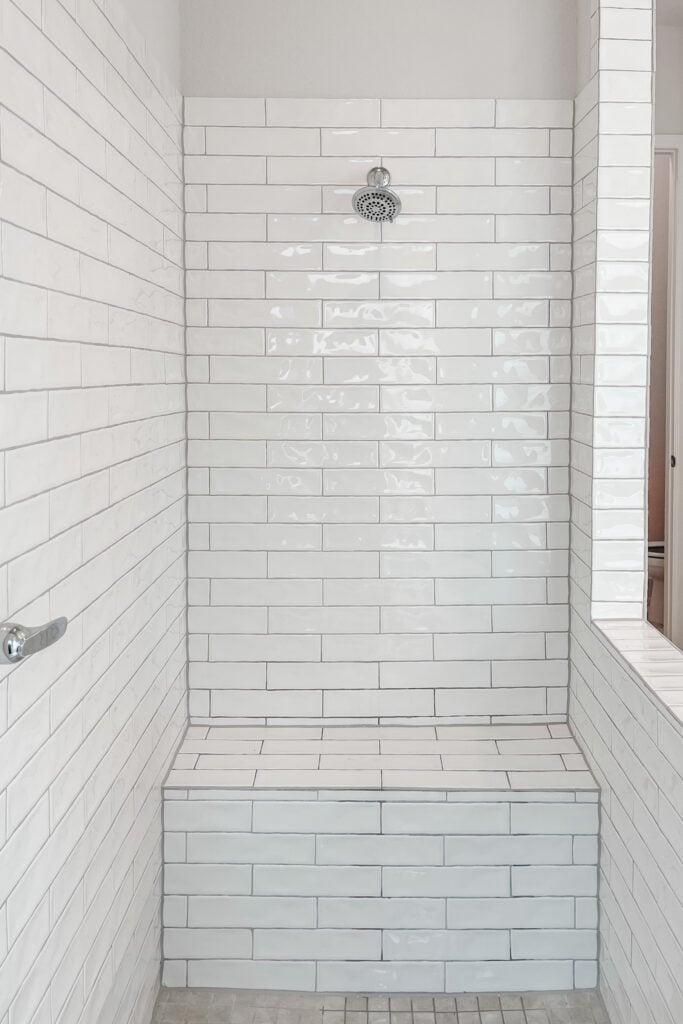 White Brick Cottage Farmhouse, New Construction Home, White Grey Marble Tile, Master Bathroom, Subway Tile Shower