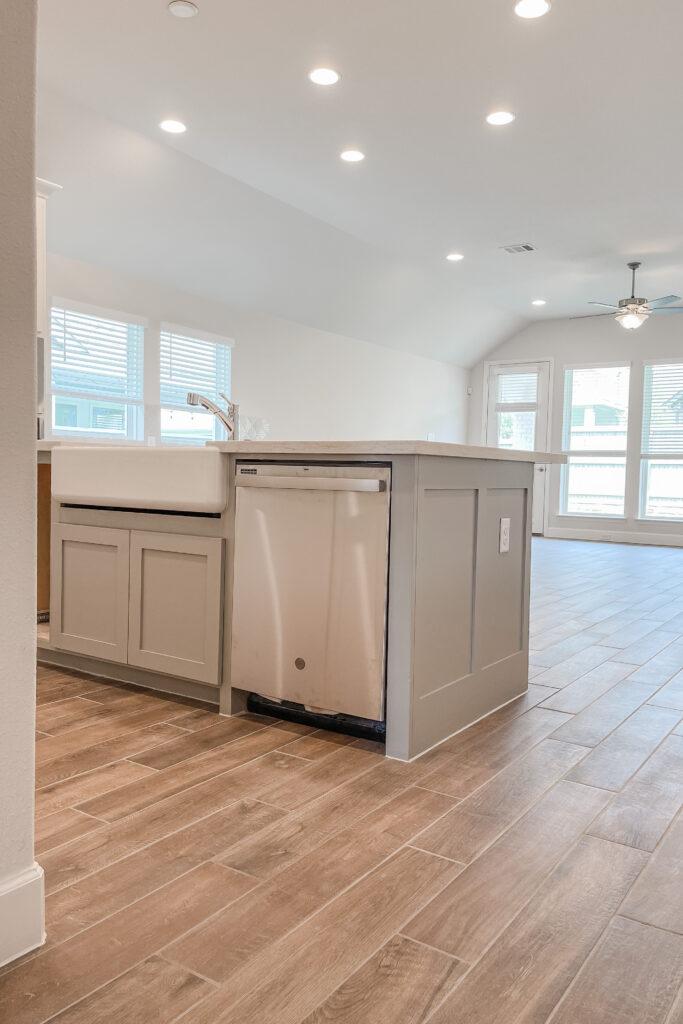 White Brick Cottage Farmhouse, New Construction Home, Wood Tile Floors, White Farmhouse Sink